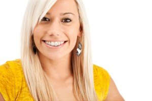 Woman with clear braces from got the orthodontics Boston residents trust for discreet, beautiful care