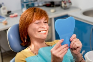 smiling woman happy with the dental implants brookline residents prefer