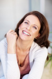 Woman with a beautiful smile thanks to dental implants in brookline